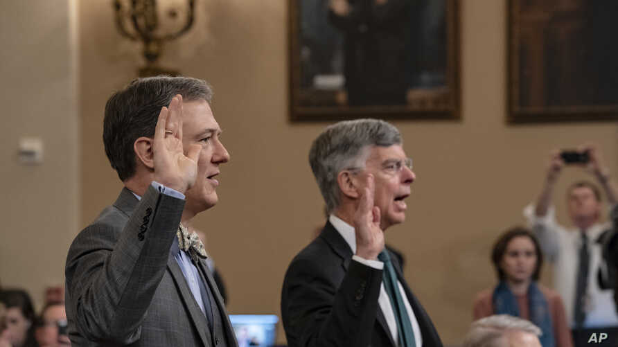 Career Foreign Service officer George Kent, left, and top U.S. diplomat in Ukraine William Taylor, right, are sworn in