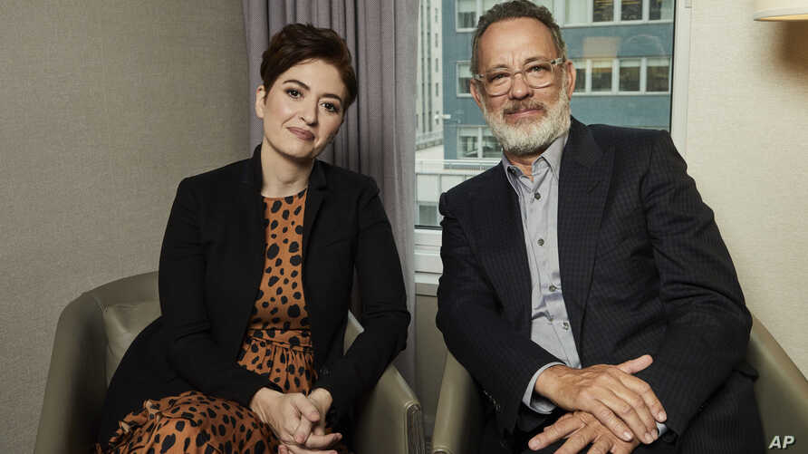 """This Nov. 17, 2019 photo shows Marielle Heller, left, and Tom Hanks pose for a portrait in New York to promote their film, """"A…"""