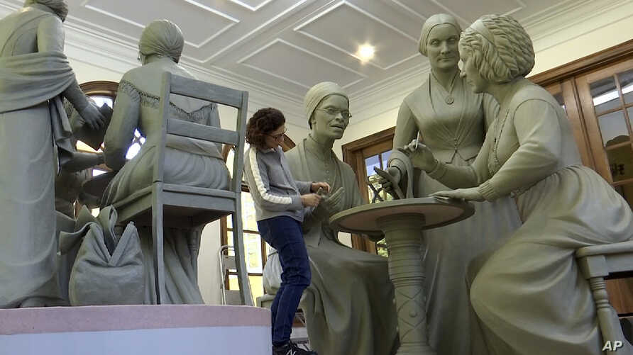 Still image from video, sculptor Meredith Bergmann works on the first women's statue that will be installed in New York's Central Park, in her studio in Ridgefield, Connecticut, Nov. 4, 2019.