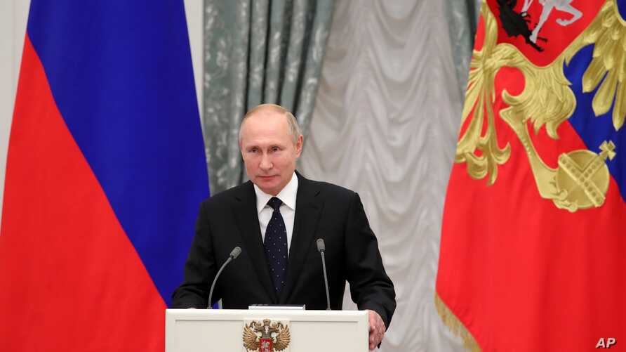 Russian President Vladimir Putin delivers his speech at the State Awards ceremony in the Kremlin in Moscow, Russia, Thursday,…