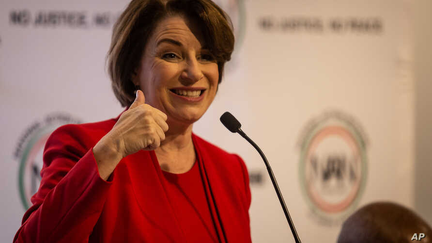 Amy Klobuchar gestures to an audience at a breakfast event on Thursday, Nov. 21, 2019, in Atlanta.