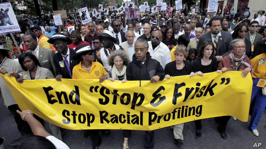 """File-This photo from June 17, 2012, shows Rev. Al Sharpton, with demonstrators during a silent march to end to end the """"stop-and-frisk"""" program in New York."""