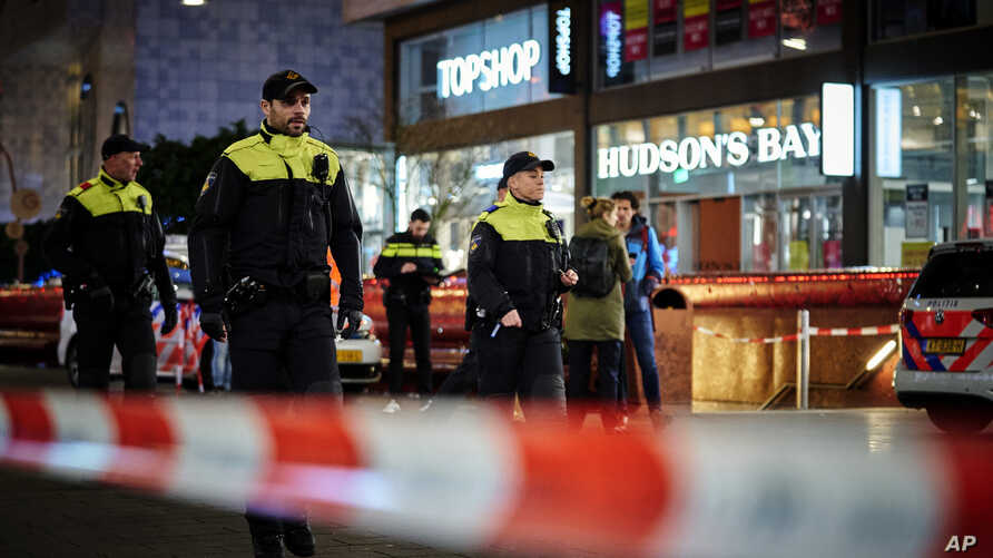 Dutch police secure a shopping street after a stabbing incident in the center of The Hague, Netherlands, Nov. 29, 2019.