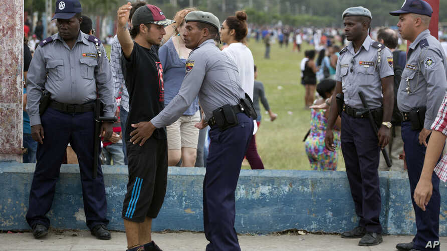 A spectator is searched by police before entering the venue for a Rolling Stones concert in Havana, Cuba, Friday March 25, 2016…