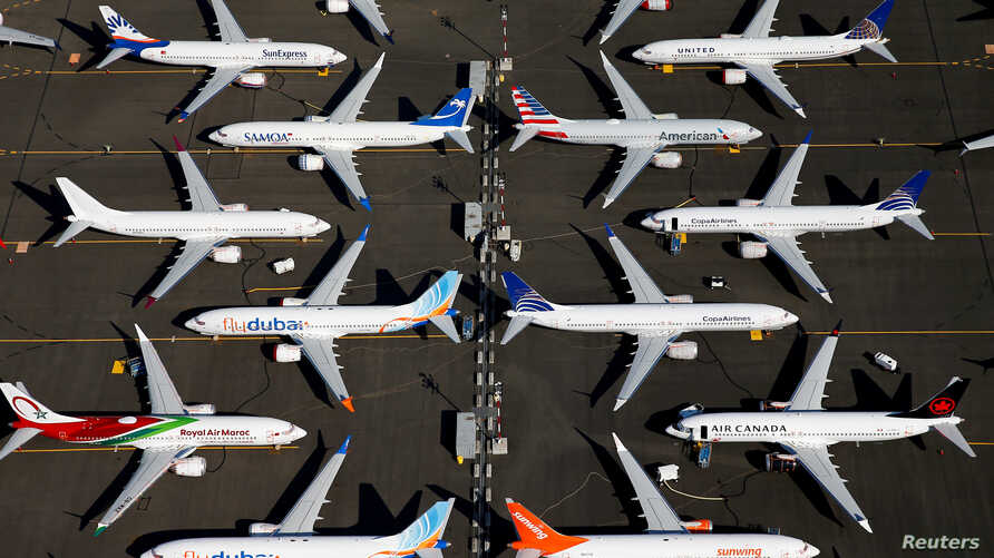 FILE PHOTO: Grounded Boeing 737 MAX aircraft are seen parked in an aerial photo at Boeing Field in Seattle, Washington, U.S…