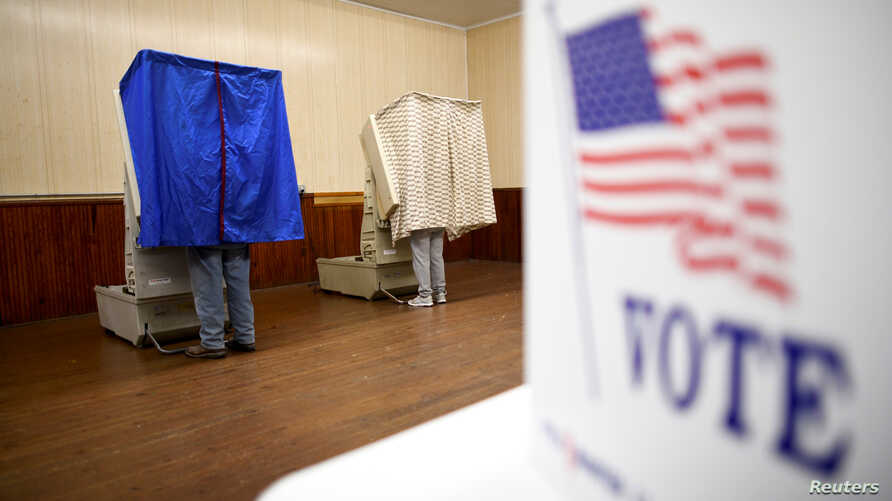 Voters cast their ballots in state and local elections at Pillow Boro Hall in Pillow, Pennsylvania, U.S. November 5, 2019. …