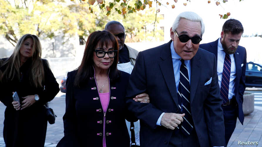 Roger Stone, former campaign adviser to U.S. President Donald Trump, arrives beside his wife, Nydia Stone, for his criminal…