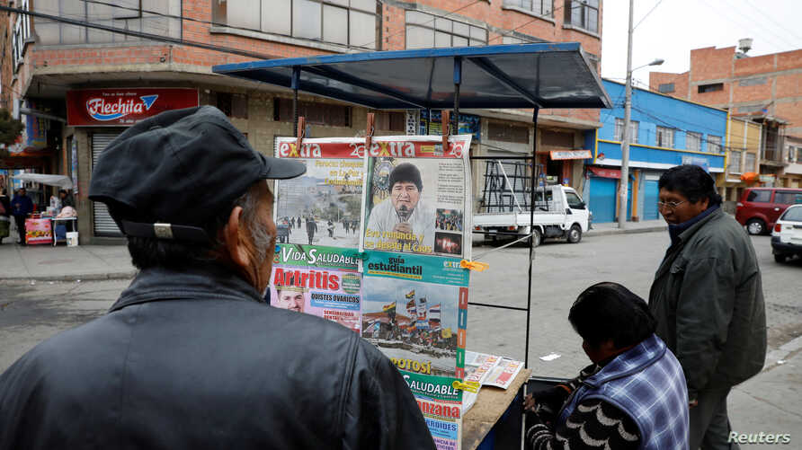 A man looks at newspapers, following Bolivia's former president Evo Morales' exit out of the country, in La Paz, Bolivia,…