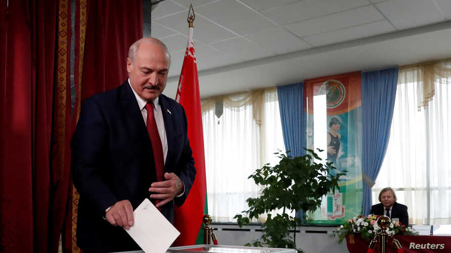FILE PHOTO: Belarusian President Alexander Lukashenko casts his vote at a polling station during the parliamentary election in…