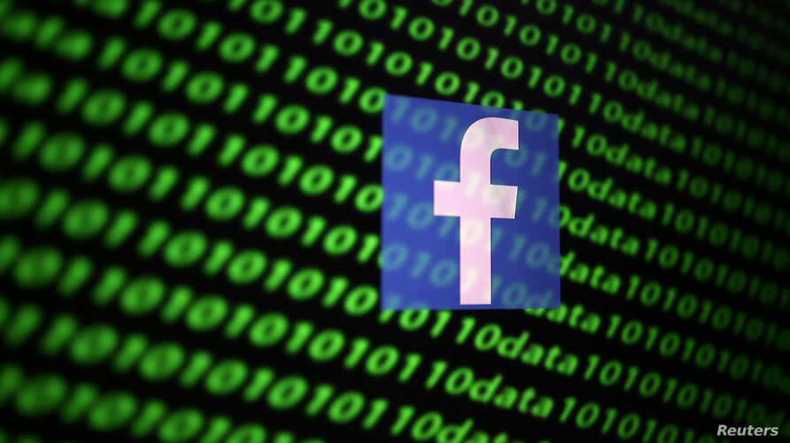 The Facebook logo and binary cyber codes are seen in this illustration taken November 26, 2019. REUTERS/Dado Ruvic/Illustration…