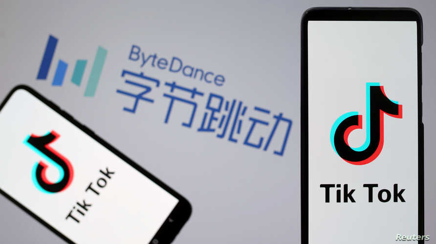 Tik Tok logos are seen on smartphones in front of a displayed ByteDance logo in this illustration taken Nov. 27, 2019.