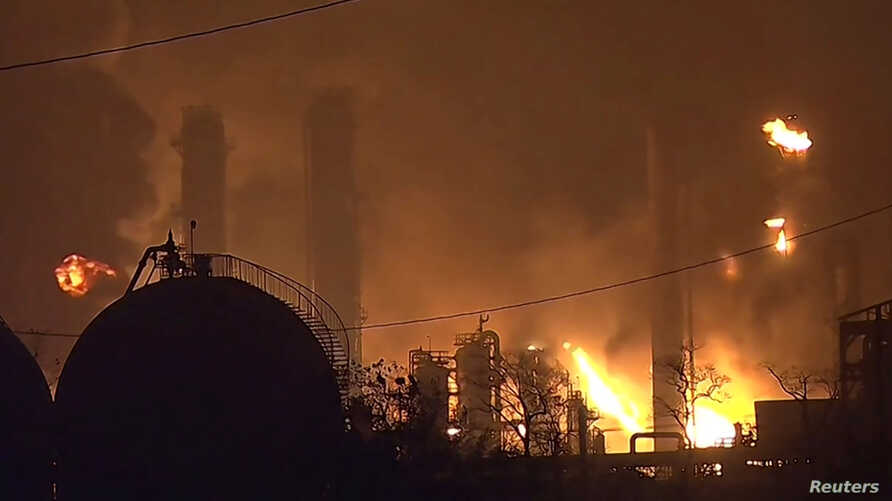 Flames rise over a petrochemical plant after an explosion in a still image from video in Port Neches, Texas, U.S., Nov. 27, 2019.