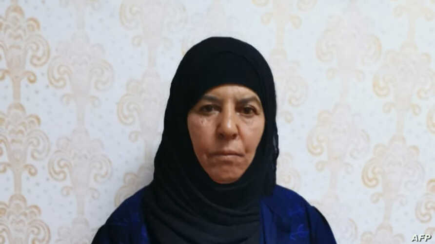 This handout undated picture taken and released by the press service of the Turkish Government, shows Rasmiya Awad, believed to be the sister of slain Islamic State leader Abu Bakr al-Baghdadi, at an unknown location.