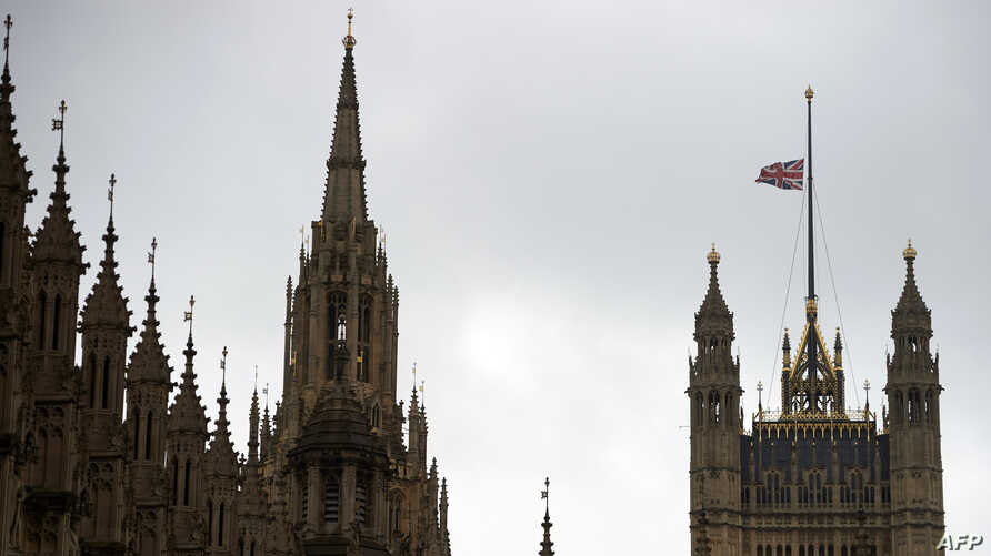 FILE - The British union flag flies at half-mast above Victoria Tower on the Palace of Westminster, in London, June 20, 2016.
