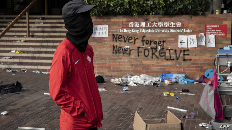 A protester stands inside the Hong Kong Polytechnic University campus where a small group of protesters continue to hold out, in the Hung Hom district in Hong Kong, Nov. 23, 2019.