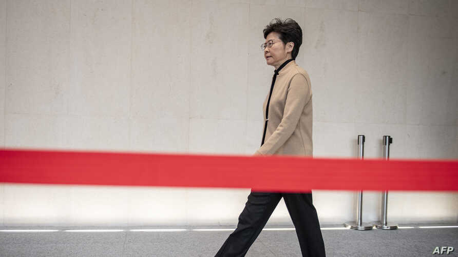 FILE - Hong Kong Chief Executive Carrie Lam arrives for a press conference in Hong Kong, Nov. 19, 2019.