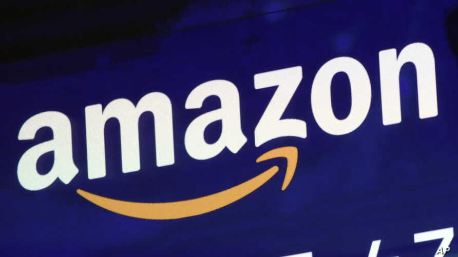 FILE - The Amazon logo is displayed on a screen at the Nasdaq MarketSite in New York, July 27, 2018.