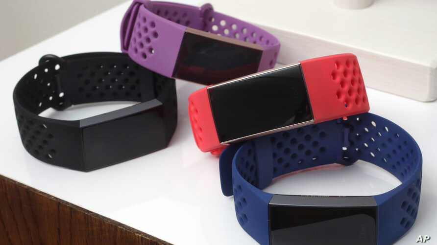 FILE - Fitbit Charge 3 fitness trackers with sport bands are displayed in New York, Aug. 16, 2018.