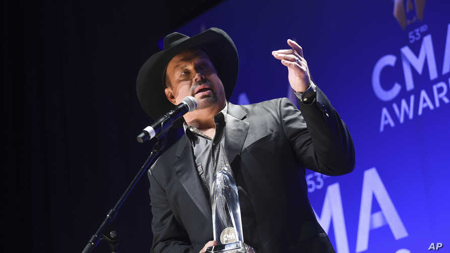 Singer-songwriter Garth Brooks speaks in the press room after winning the entertainer of the year award at the 53rd annual CMA Awards, at Bridgestone Arena, in Nashville, Tennesee, Nov. 13, 2019.