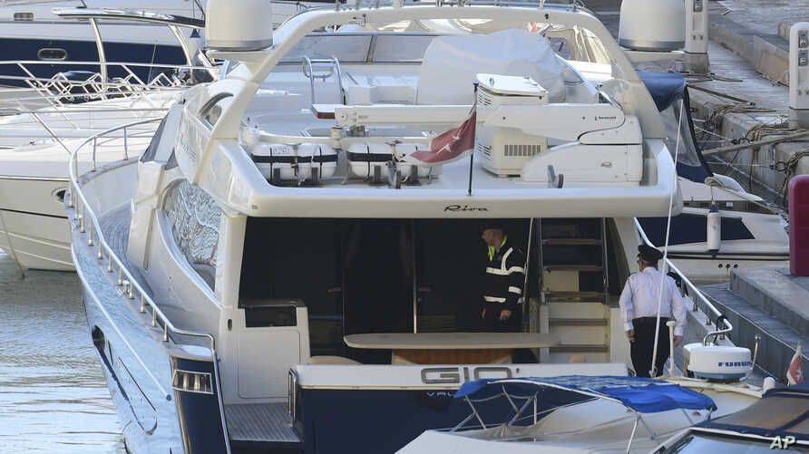 """Police aboard the yacht """"Gio"""" after it was intercepted on a course for Sicily by the Maltese military, Nov. 20, 2019, and forced back to Portomaso."""