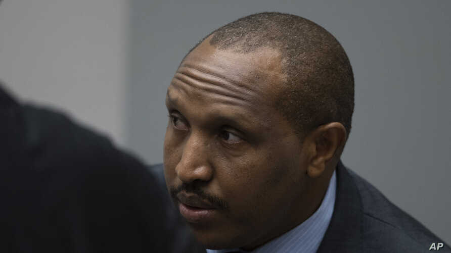 Congolese militia commander Bosco Ntaganda enters the courtroom of the International Criminal Court, or ICC, to hear the…