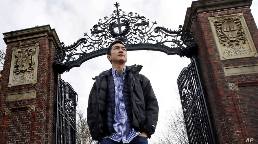 FILE - Harvard University graduate Jin K. Park, who holds a degree in molecular and cellular biology, poses at a gate at Harvard Yard in Cambridge, Massachusetts, Dec. 13, 2018. Park was among last year's Rhodes scholars.