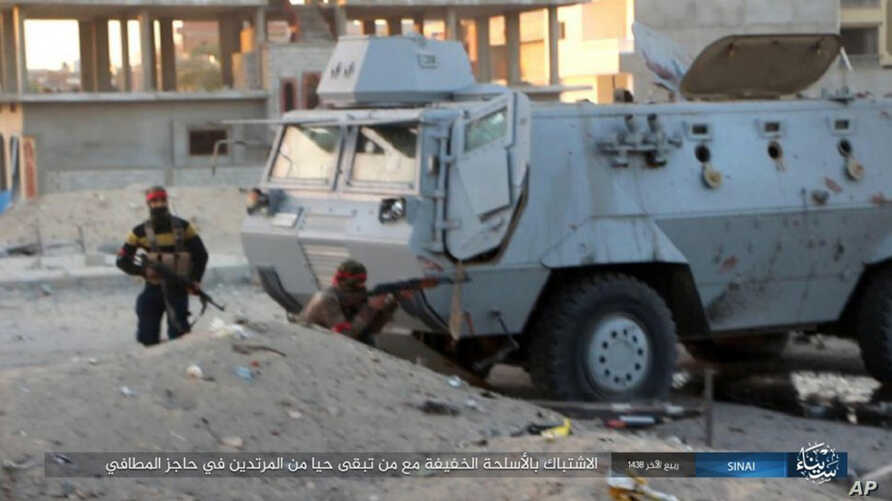 FILE - This photo posted on a file sharing website Jan. 11, 2017, by the Islamic State Group in Sinai shows a deadly attack by militants on an Egyptian police checkpoint, Jan. 9, 2017, in el-Arish, north Sinai, Egypt.