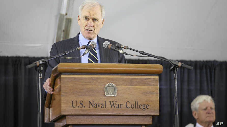 FILE - Secretary of the Navy Richard Spencer addresses graduates during the U.S. Naval War College's commencement ceremony, in Newport, Rhode Island, June 14, 2019.