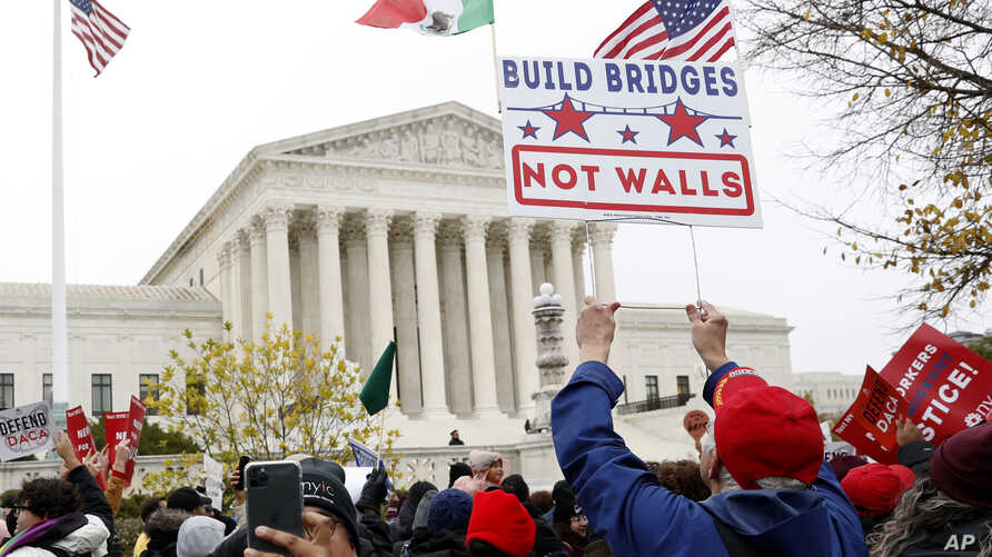 People rally outside the Supreme Court as oral arguments are heard in the case of President Trump's decision to end the Obama-era, Deferred Action for Childhood Arrivals program (DACA), Nov. 12, 2019, at the Supreme Court in Washington.
