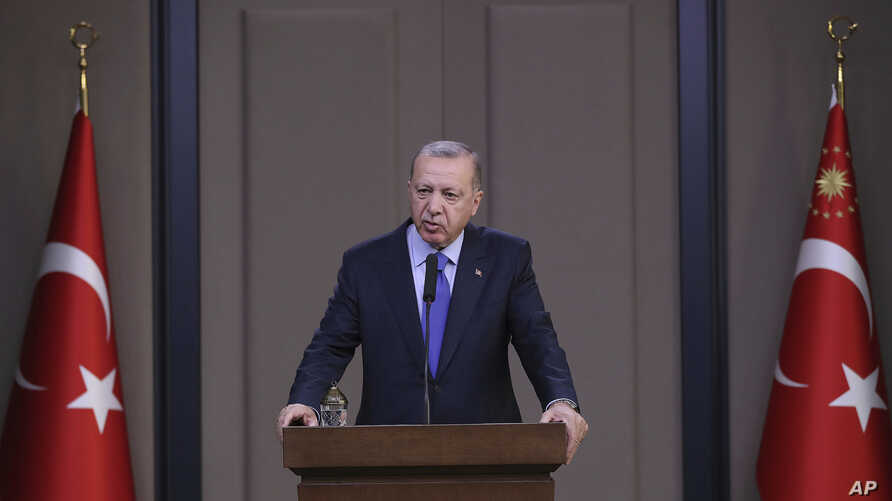 Turkish President Recep Tayyip Erdogan speaks to reporters  in Ankara before a visit to the United States, Nov. 12, 2019.