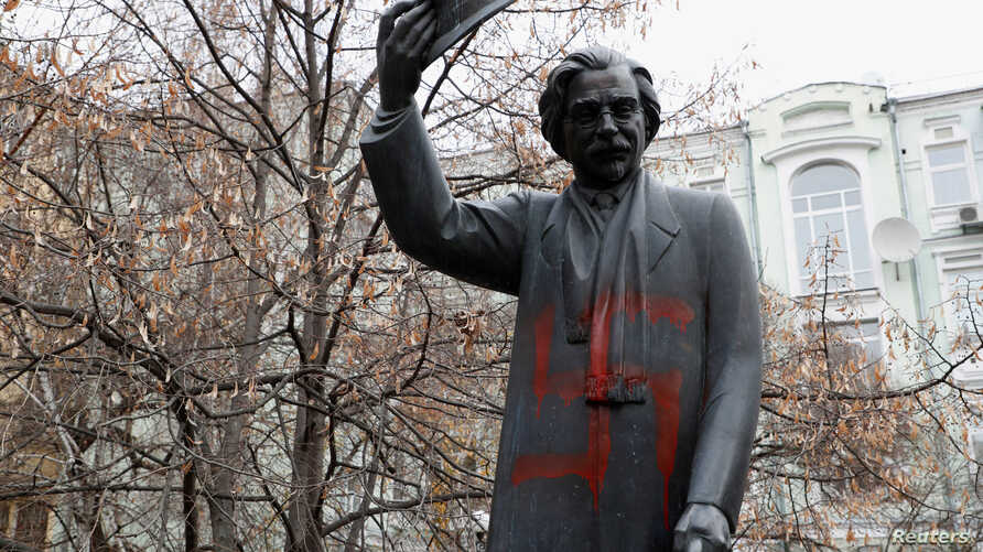 A monument to Yiddish author Sholem Aleichem is seen vandalized with a swastika in Kyiv, Ukraine, Nov. 25, 2019.