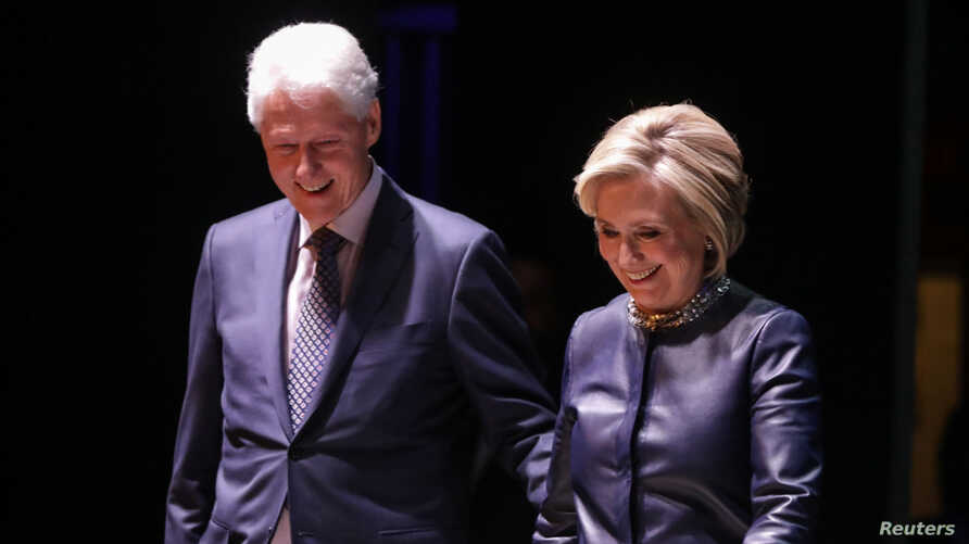 FILE - Former Secretary of State Hillary Clinton and former President Bill Clinton appear together at an event at Beacon Theatre in New York, April 11, 2019.