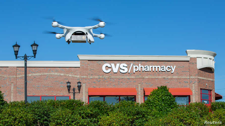 A UPS Flight Forward drone takes off during the first residential delivery of prescription medication for CVS in Cary, North Carolina, Nov. 1, 2019.