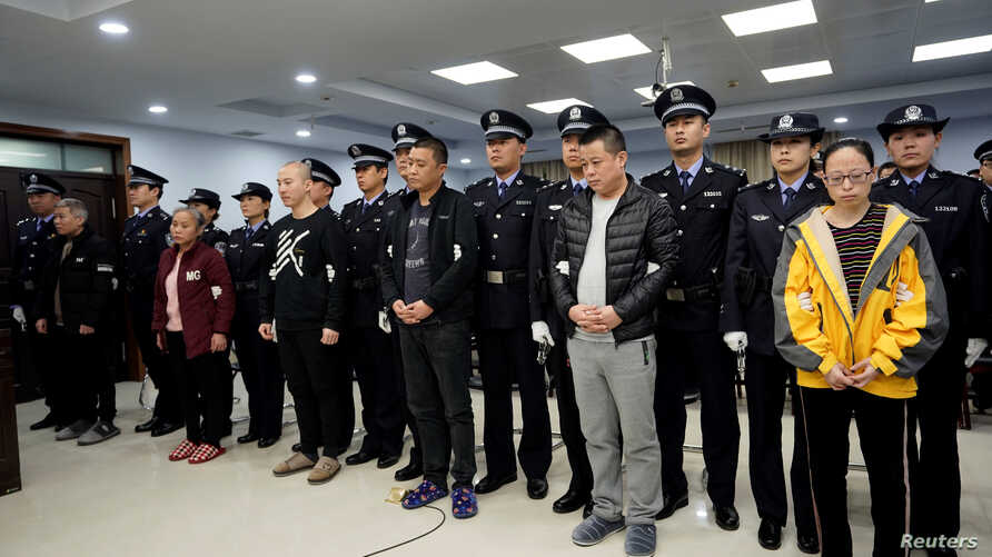 People charged with smuggling fentanyl to the U.S. are seen during a court sentencing in Xingtai, Hebei province, China, Nov. 7, 2019 in this handout picture provided by China National Narcotics Control Commission.