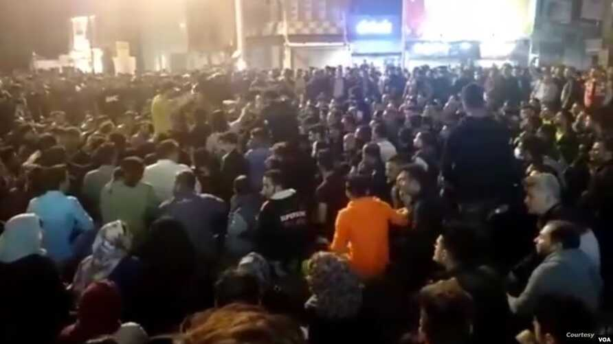 Residents of Behbahan in southwestern Iran stage a sit-in on a street on Nov. 15, 2019, in protest at the government's sudden 50% increase in the subsidized price of gasoline earlier in the day. (Courtesy)
