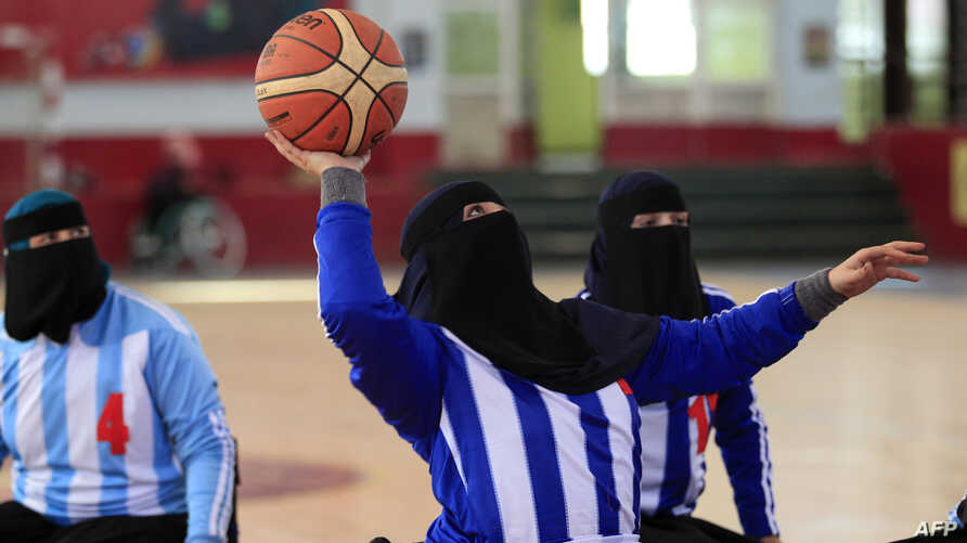 Disabled Yemeni women take part in a local wheelchair basketball championship in Yemen's capital Sanaa on December 9, 2019. …