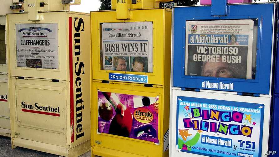 The Fort Lauderdale Sun-Sentinel, The Miami Herald and El Nuevo Herald sit in newsstands early 08 November 2000 in North Miami…