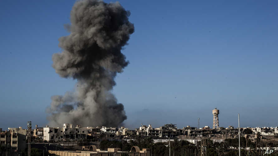 FILE - In this Sept. 28, 2016 file photo, smoke rises after an airstrike on an Islamic State militants held area in Sirte,…