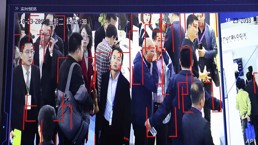Visitors are tracked by facial recognition technology from state-owned surveillance equipment manufacturer Hikvision at the Security China 2018 expo in Beijing, China, Oct. 23, 2018.