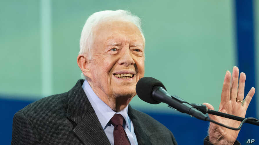 FILE - In this Sept. 18, 2019, file photo former President Jimmy Carter acknowledges a student who's question has been picked…