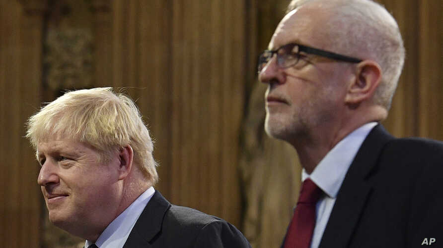 Britain's Prime Minister Boris Johnson, left, and main opposition Labour Party leader Jeremy Corbyn attend the official State…