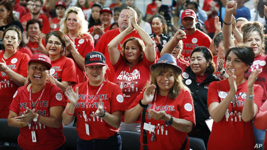 FILE - In this Nov. 5, 2018, file photo, Culinary Union members cheer as they rally in support of Rep. Jacky Rosen, D-Nev., and…