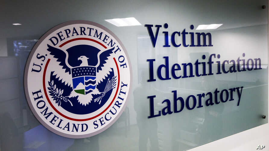 A sign to the Victim Identification Lab, part of Homeland Security's Child Exploitation Investigations Unit, is seen in Fairfax…