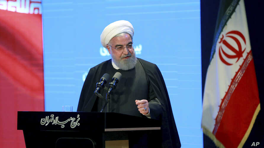 In this photo released by the official website of the Office of the Iranian Presidency, President Hassan Rouhani speaks