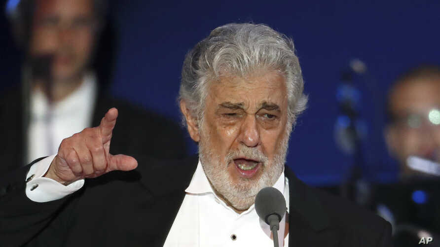 FILE- In this Aug. 28, 2019, file photo, opera singer Placido Domingo performs during a concert in Szeged, Hungary.  In an…