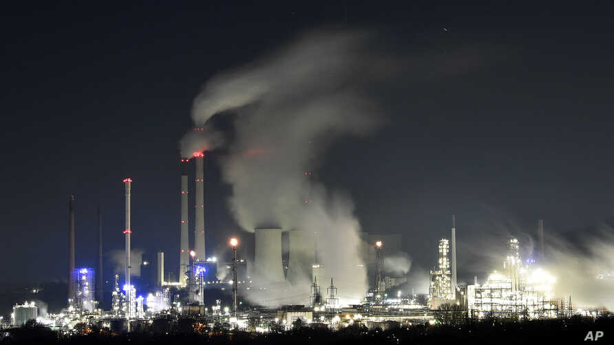 A Uniper coal-fired power plant and a BP oil refinery and chemical plant are at work in Gelsenkirchen, Germany, on Wednesday evening, Dec. 4, 2019.