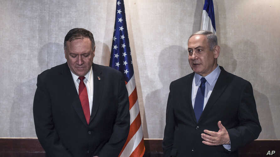 US Secretary of State Mike Pompeo and Israeli Prime Minister Benjamin Netanyahu speak during their meeting in Lisbon Wednesday,…