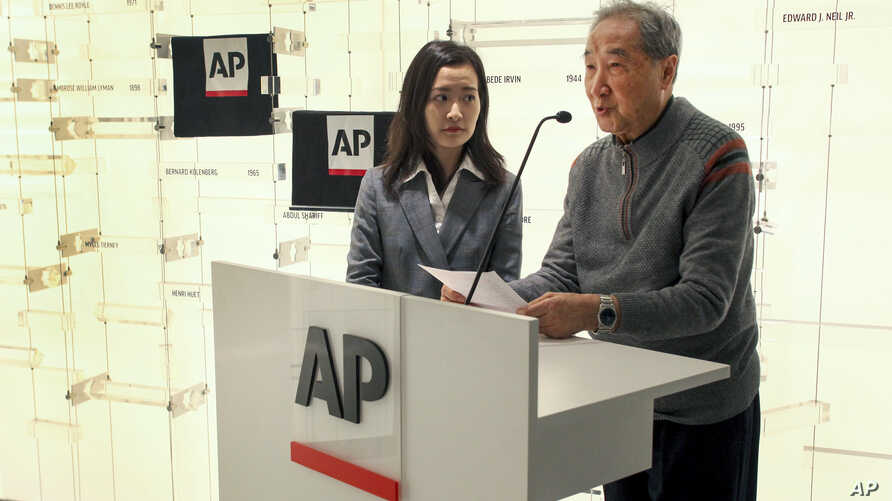 Rao Jian, right, son of Y.C. Jao, speaks during a ceremony at the Associated Press headquarters, in New York, Dec. 11, 2019, honoring Jao for his service as a Chinese correspondent working for the AP in China.
