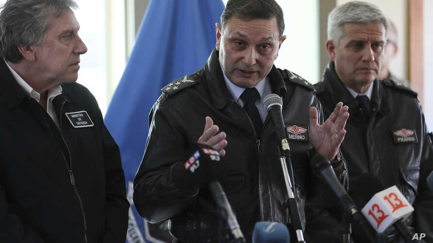 Chile's Air Force Commander Arturo Merino, center, speaks during a news conference at the Chilean Air Force base in Punta Arenas, Chile, Dec. 12, 2019.