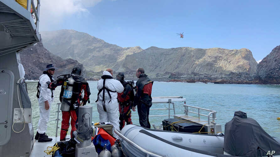 Police divers prepare to search the waters near White Island off the coast of Whakatane, New Zealand, Dec. 14, 2019.